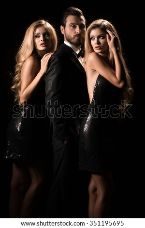 Portrait of a young fashion couple looking into the camera. Woman two times.  - stock photo