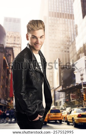Portrait of a young fashion man walking in NYC - stock photo