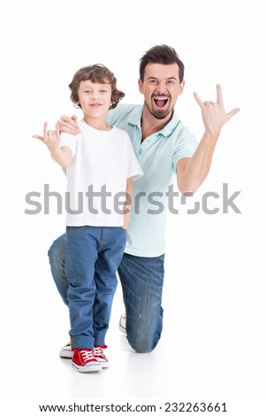 Portrait of a young father and his son on a white background. - stock photo