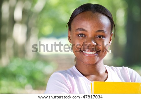 portrait of a young female african american university student - stock photo