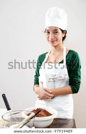 Portrait of a young female chef - stock photo