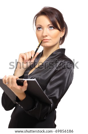 Portrait of a young female entrepreneur thinking while taking notes against white background - stock photo