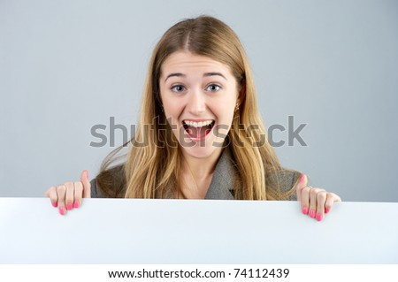 Portrait of a young female holding a blank bill board - stock photo