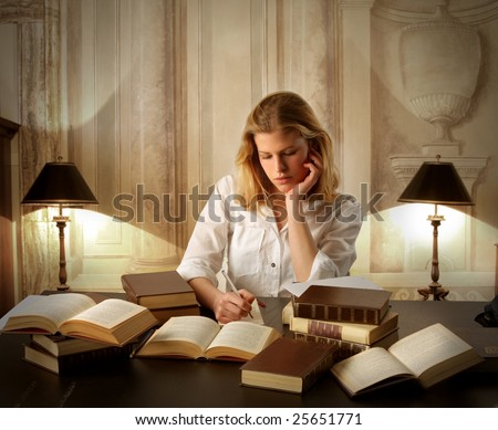 portrait of a young female student underlining and reading books in a ancient interior - stock photo