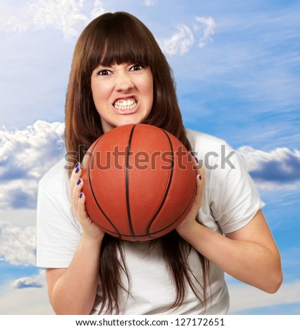 Portrait Of A Young Female With A Basket Ball, Outdoor