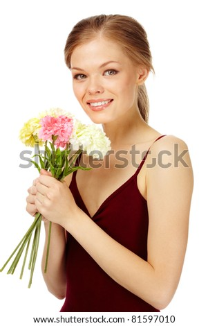 Portrait of a young female with bouquet of fresh carnations looking at camera - stock photo