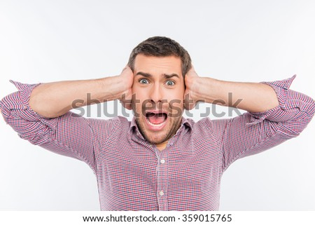Portrait of a young furious man - stock photo