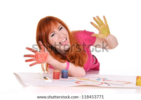 portrait of a young girl drawing on the floor - stock photo