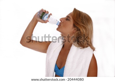 Portrait of a young girl; drinking water and ready for a fitness class;