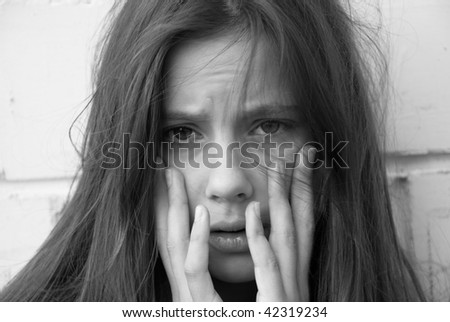 Portrait of a young girl in despair - stock photo