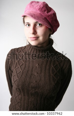 Portrait of a young girl in rose cap - stock photo