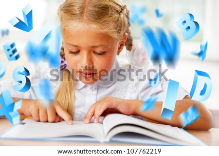Portrait of a young girl in school at the desk. Reading book and dreaming. Graphic 3d symbols flying around her