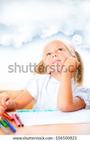 Portrait of a young girl in school at the desk. Vertical Shot. Daydreaming. Blank cloud with copyspace for your text - stock photo
