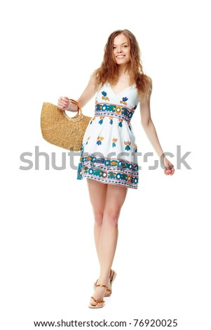 Portrait of a young girl in summer dress and with basket - stock photo