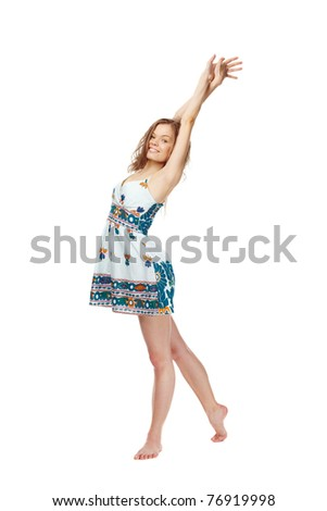 Portrait of a young girl in sundress stretching herself - stock photo