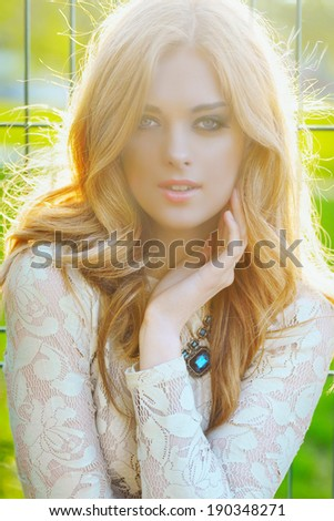 portrait of a young girl in sunlight outdoor - stock photo
