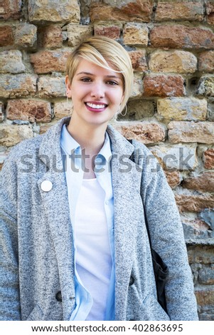 Portrait of a young girl in the front wall  - stock photo