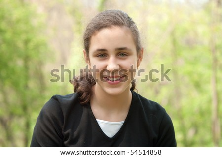 Portrait of a young girl in the park - stock photo