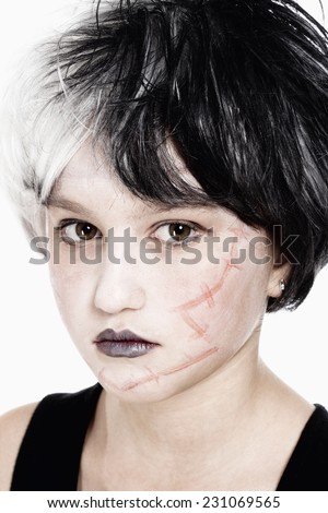 Portrait of a Young Girl in Wig Posing as Frankenstein - stock photo