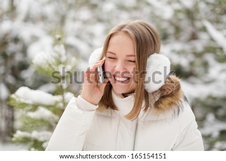 Portrait of a young girl in winter forest