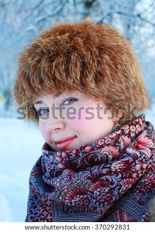Portrait of a young girl in winter outdoor