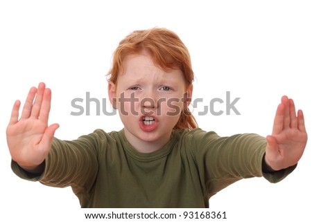 Portrait of a young girl making stop gesture on white background - stock photo