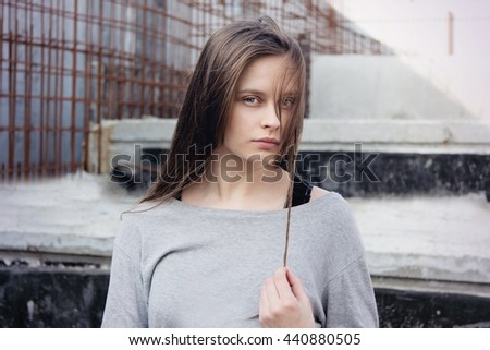 Portrait of a young girl on a background of construction
