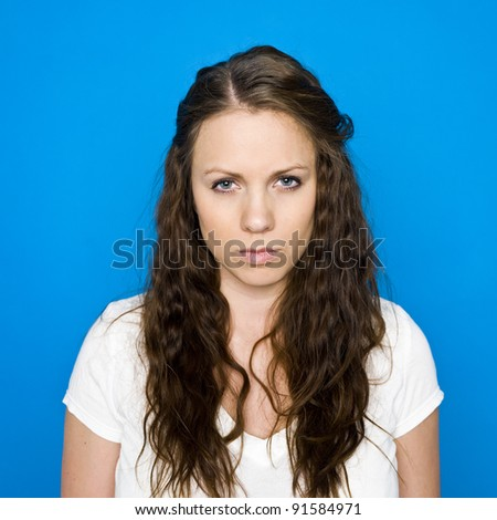 Portrait of a young girl on blue background - stock photo