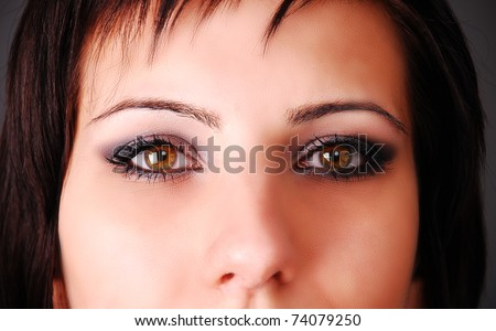 Portrait of a young girl on dark background - stock photo