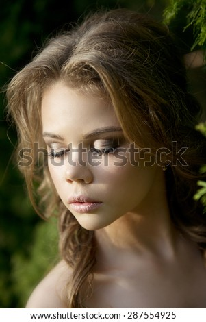 Portrait of a young girl on nature background