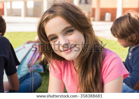 Portrait of a young girl on school campus - stock photo