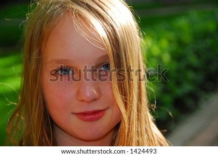 Portrait of a young girl outside at summertime