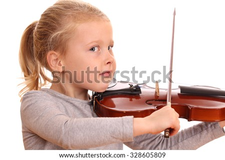 Portrait of a young girl playing violin on white background - stock photo
