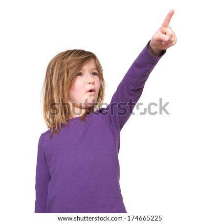 Portrait of a young girl pointing finger on isolated white background - stock photo