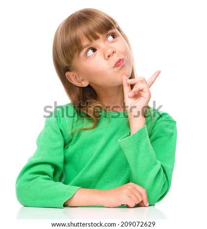 Portrait of a young girl pointing to the right using her index finger, isolated over white - stock photo