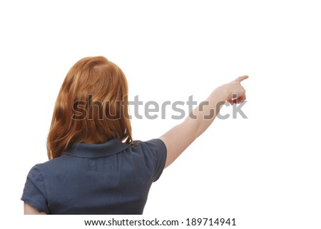 Portrait of a young girl pointing up on white background - stock photo