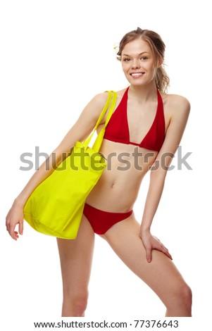 Portrait of a young girl posing in red bikini - stock photo
