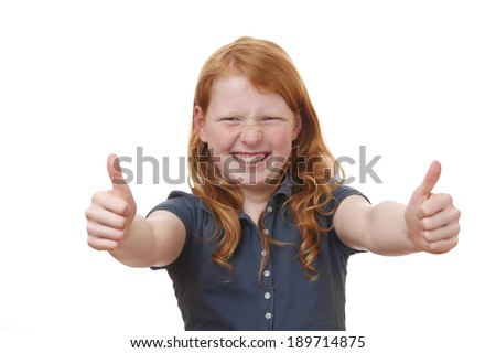 Portrait of a young girl showing thumbs up on white background - stock photo