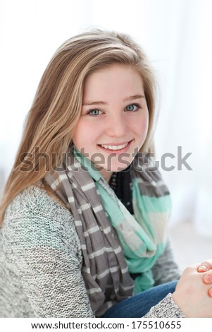 portrait of a young girl sitting on the floor - stock photo