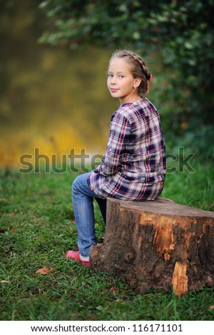 portrait of a young girl. Sunny summer day - stock photo