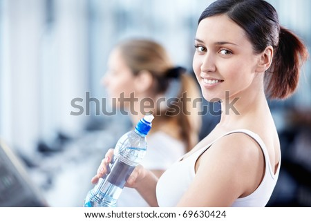Portrait of a young girl with a bottle of water - stock photo