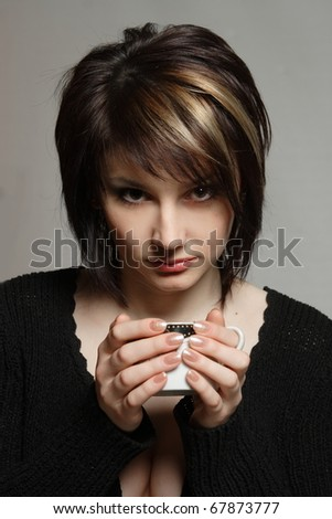 portrait of a young girl with a cup of coffee