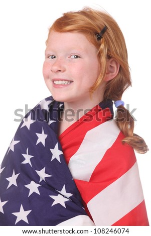 Portrait of a young girl with an american flag on white background