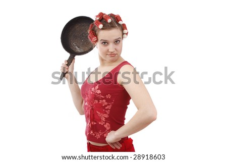 Portrait of a young girl with an angry expression. Very frustrated and angry mad woman. Woman in hair rollers.  Angry look on face. Studio, white background. - stock photo