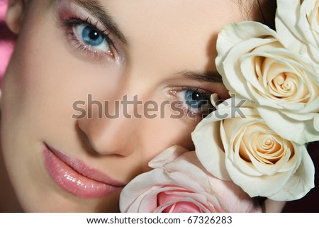portrait of a young girl with blue eyes and with roses - stock photo