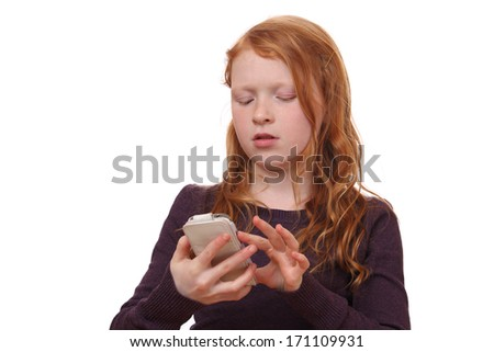 Portrait of a young girl with cell phone on white background - stock photo