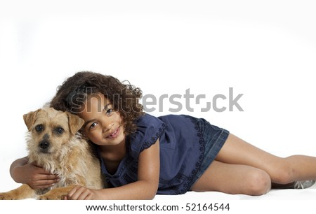Portrait of a young girl with dreadlocks and frizzy hair, hugging a small dog. White background. - stock photo