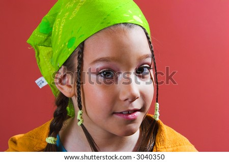 Portrait of a young girl with green kerchief and braids