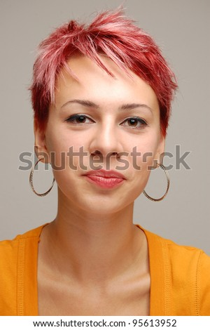 portrait of a young girl with red hair, isolated on gray - stock photo
