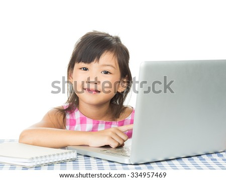Portrait of a young girl working on laptop,on the white background.